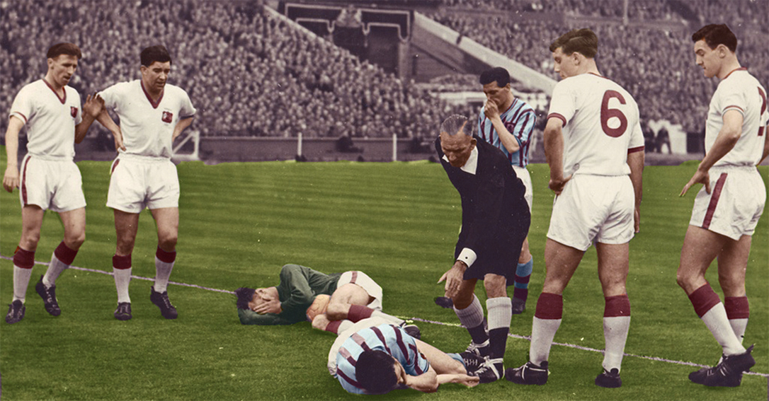 c39800525 McParland  The Northern Irish forward lies on the floor after a collision  with Manchester United goalkeeper Ray Wood during the 1957 FA Cup final